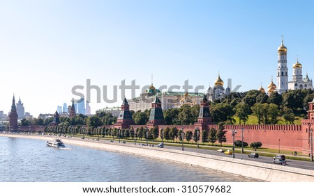 Moscow skyline - panoramic view of The Kremlin embankment, Kremlin buildings, walls, towers, Moscow City in summer afternoon - stock photo