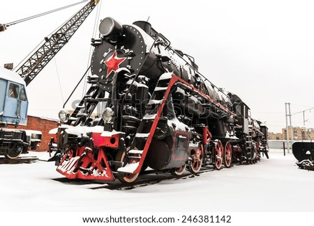 Moscow, winter, repair depot of old Soviet steam locomotive. - stock photo