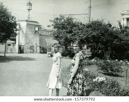 MOSKOW - CIRCA 1958: Two young woman taking a walk in the Exhibition of Economic Achievements, Exhibition Center, Moscow, 1958