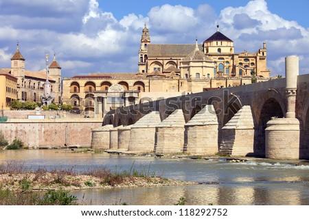Mosque Cathedral (Spanish: La Mezquita) and Roman Bridge on Guadalquivir river in Cordoba, Spain, Andalusia region. - stock photo