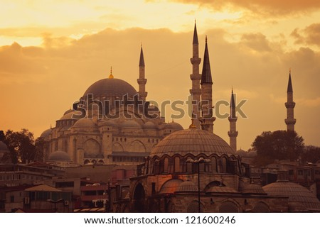 Mosque in Istanbul at sunset. The view from the Galata Bridge - stock photo