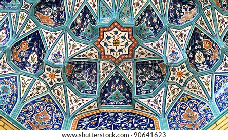 Mosque mugarnas (Complex geometrical interlacing of components to produce three-dimensional surface) - stock photo