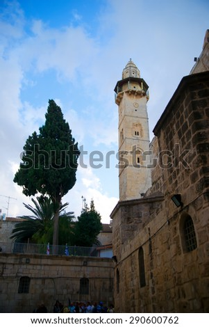 Mosque of Omar minaret, view from the yard of Holy Sepulchre, Jerusalem, Israel - stock photo