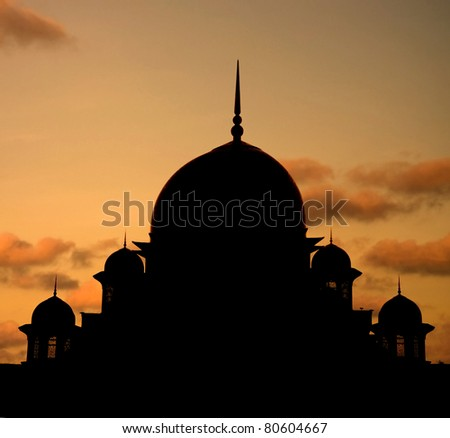 mosque silhoutte during sunset at putrajaya , malaysia - stock photo