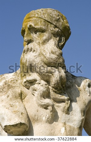 Moss covered man statue in Villa Pamphili,Rome, Italy.