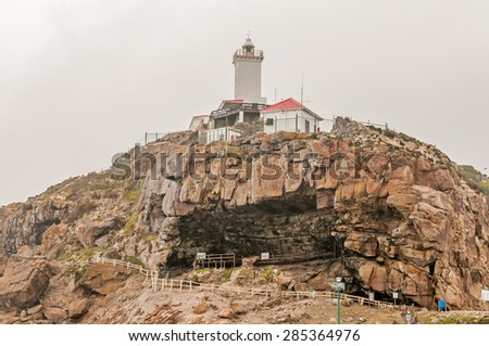 MOSSELBAY, SOUTH AFRICA - DECEMBER 27, 2014: The Cape St. Blaize lighthouse at The Point. The cave below the lighthouse is an important archaeological site