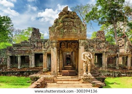 Mossy entrance to ancient Preah Khan temple in Angkor, Siem Reap, Cambodia. Mysterious Preah Khan temple has been swallowed by jungle. Enigmatic Preah Khan is a popular tourist attraction. - stock photo