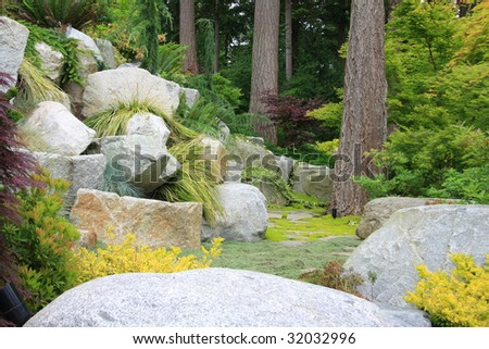 Mossy path in a rocky garden. - stock photo