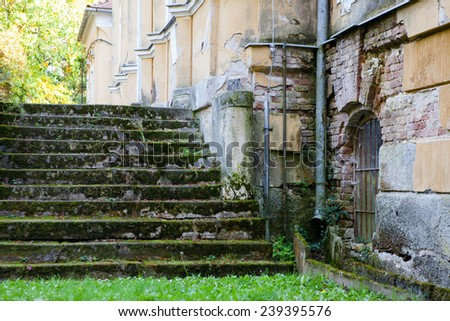 Mossy stone steps to abandoned noble castle - stock photo
