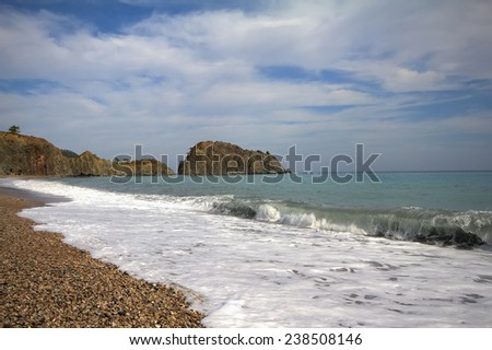 most beautiful pebble beach Mediterranean Sea - stock photo