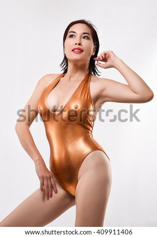Most beautiful sexy hot Asian woman sexy posing wearing copper one piece bikini isolate in White background - stock photo