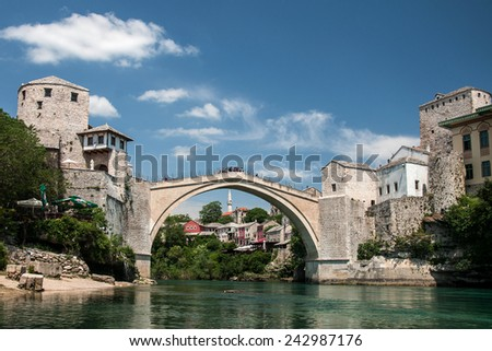 MOSTAR, BOSNIA AND HERZEGOVINA, MAY 12, 2010 - The famous bridge in Mostar, destroyed by war in 1993 and restored again and opened in 2004 - stock photo