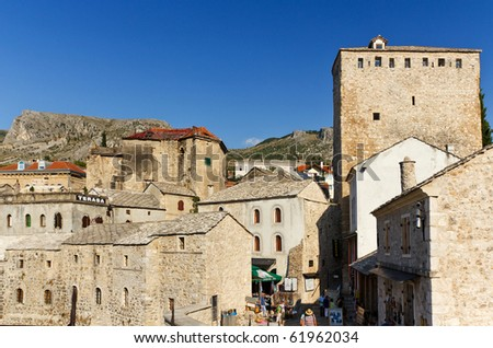 MOSTAR, BOSNIA AND HERZEGOVINA- SEPTEMBER 24: Tourists Enjoying the Old Town Marketplace at the Foot of the Historic Old Bridge On September 24, 2010 in Mostar, Bosnia and Herzegovina - stock photo