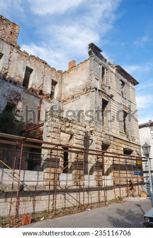 MOSTAR, BOSNIA-HERZEGOVINA - OCTOBER 24, 2014: destroyed building in the city centre of Mostar. The signs of the Yugoslavian wars are still visible on many buildings in Mostar. - stock photo