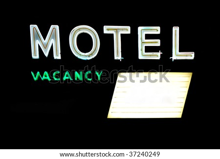 Motel and vacancy neon signs with message board isolated on black background - stock photo