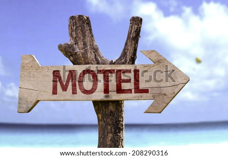 Motel wooden sign with a beach on background  - stock photo