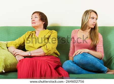Mother and adult daughter after quarrel - stock photo
