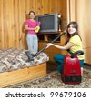 mother and adult daughter are doing house cleaning - stock photo