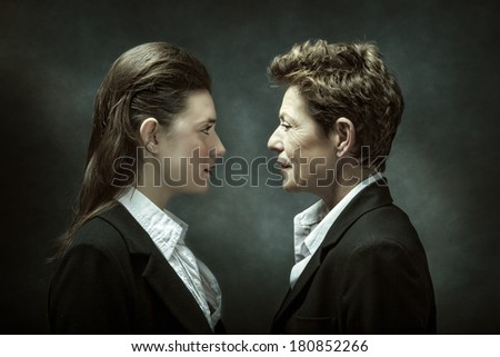 Mother and adult daughter - two generations. - stock photo