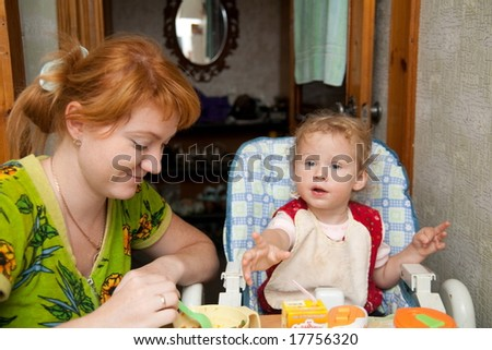 mother and baby eating - stock photo