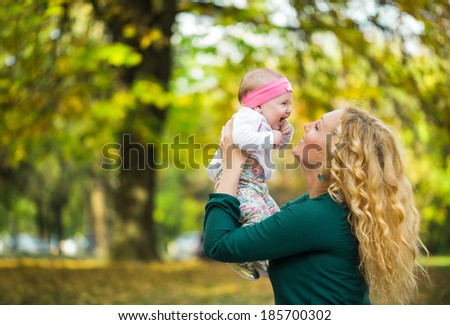 mother and baby enjoying in park  - stock photo