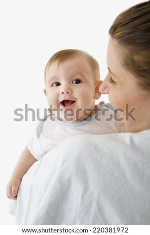 Mother and baby giggling together