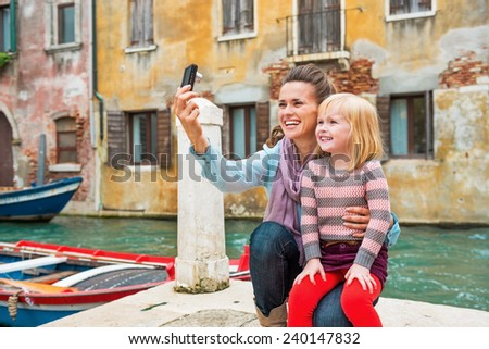 Mother and baby girl making selfie in venice, italy - stock photo