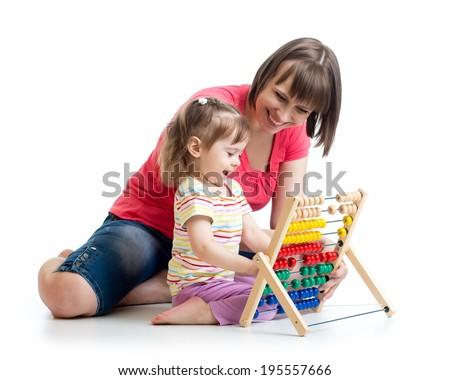 mother and baby girl play with counter toy - stock photo