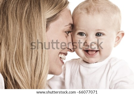 Mother and baby girl smiling - stock photo
