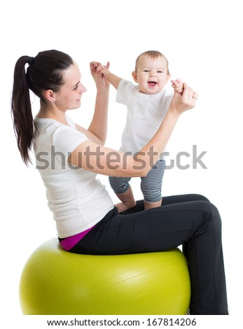 mother and baby having fun with  gymnastic ball - stock photo