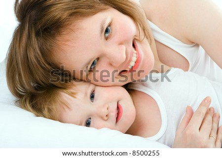 mother and baby in bed - stock photo