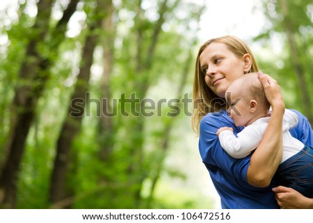 Mother and baby in park - stock photo