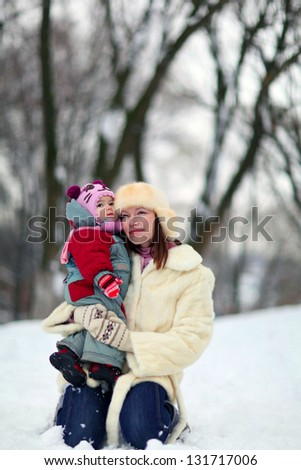 Mother and baby in winter - stock photo