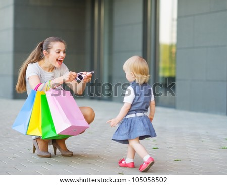 Mother and baby on shopping - stock photo