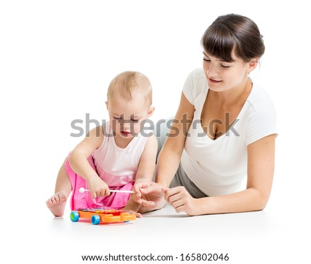 Mother and baby play musical toy isolated on white background - stock photo