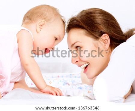 Mother and Baby playing and Laughing. Mom With her Child. Happy Family - stock photo