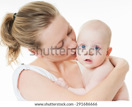 Mother and baby playing and smiling. Happy family. - stock photo