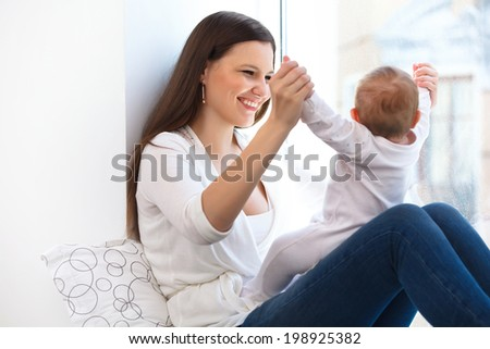 Mother and Baby playing. Happy Family - stock photo