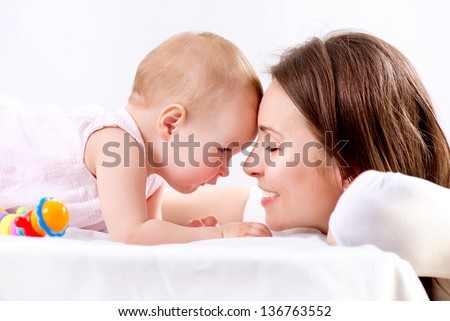 Mother and Baby playing. Happy Family. Mom With her Child. - stock photo