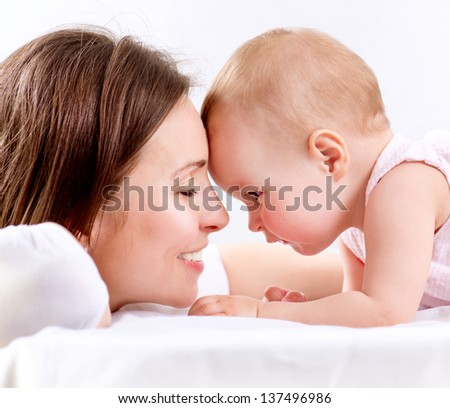 Mother and Baby playing. Happy Family. Mom With her Child.