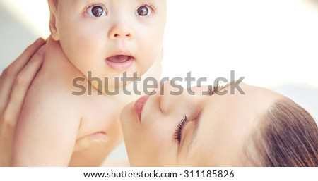 Mother and baby relaxing - stock photo