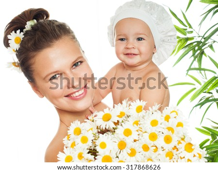 Mother and baby smiling. Happy family. - stock photo