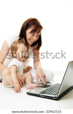 Mother and baby with laptop isolated on white - stock photo