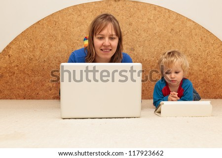 mother and baby working from home - stock photo