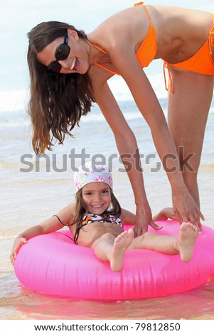 Mother and child at the beach - stock photo