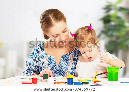 mother and child baby daughter draw paints - stock photo