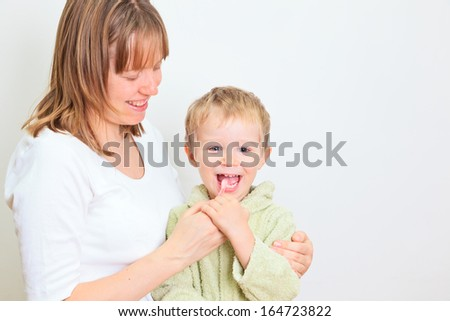 mother and child brushing teeth together. Dental hygiene. - stock photo