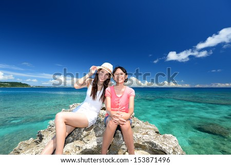Mother and child enjoy the sun - stock photo