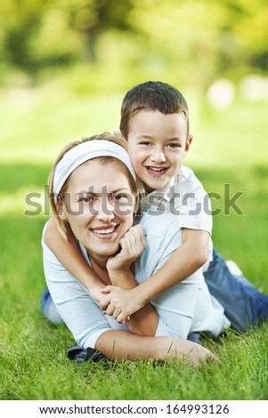 Mother and child having fun in the park