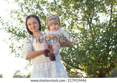 Mother and child in garden - stock photo